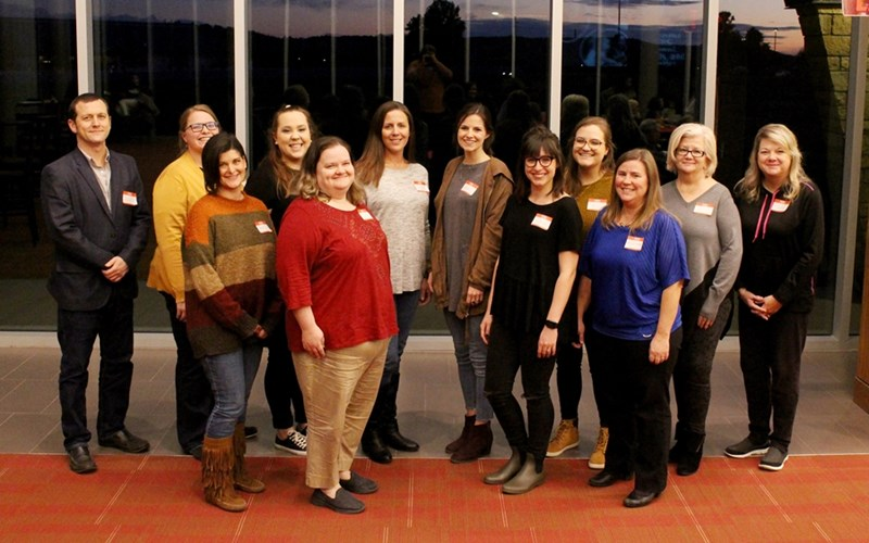 Shelley McNally, executive director of education programs at the Jean Tyson Child Development Study Center (front right), and the entire staff of the Jean Tyson Child Development Study Center were honored at the School of Human Environmental Sciences Alumni, Friends and Families event.