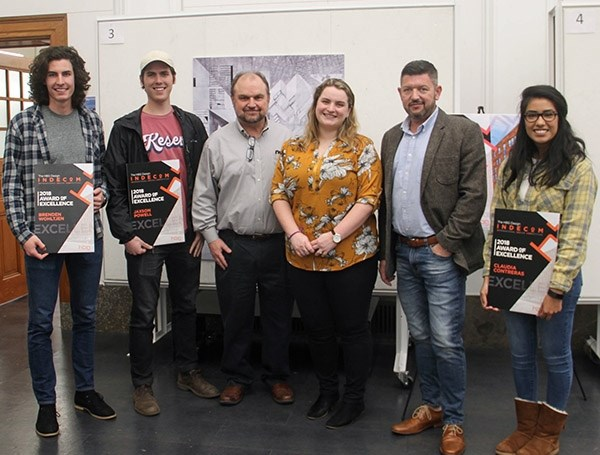 Fay Jones School students Brenden Wohltjen, Jaxson Powell and Claudia Contreras are shown with Mark Weaver, third from left, Kelly Grecco and Landon Shockey, all of HBG Design.