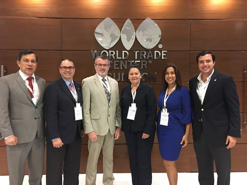 Melvin Torres (second to left), director of Western Hemisphere Trade for the World Trade Center Arkansas, stands with Scott Ferguson (right of Torres), president and CEO of the World Trade Center Association, and other members of the WTCA Latin America region.