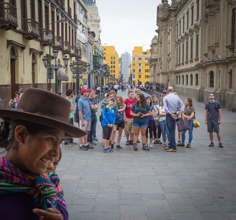Honors students and professors take a walking tour in Lima's historic district as part of the Honors Passport: Peru study abroad experience in 2017.