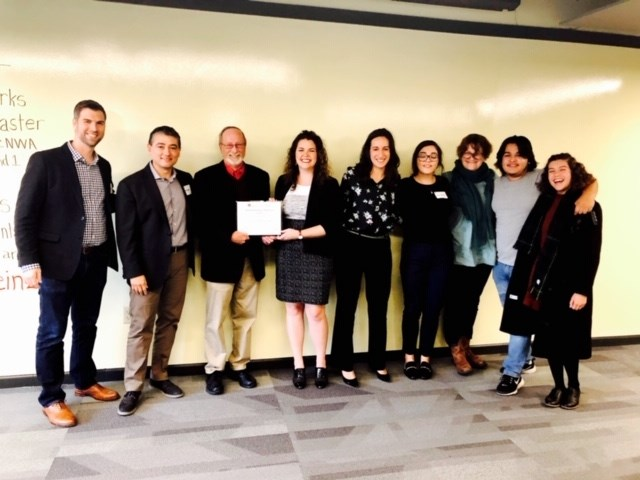 Students enrolled in Social Justice in the Arts were awarded first place in the interdisciplinary Social Innovation Challenge after presenting their collaborative community-building work with the Teen Action Support Center and The Station in Springdale.