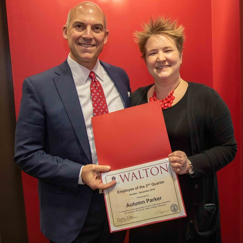 Dean Matt Waller recognizes Autumn Parker as the employee of the second quarter for the Sam M. Walton College of Business.