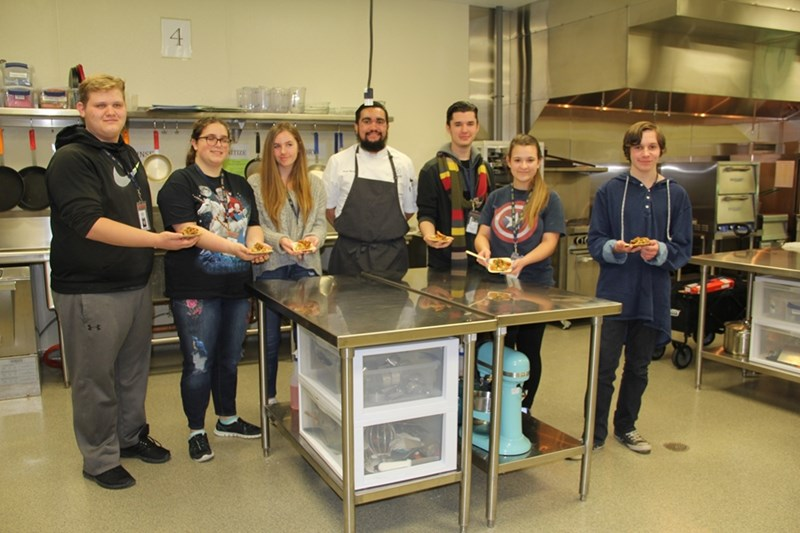 Food and culinary sciences student Sergio Herrera (center) spoke to culinary students at Bentonville West High School about how food, science, chemistry, sensory and safety all come together in the food industry.