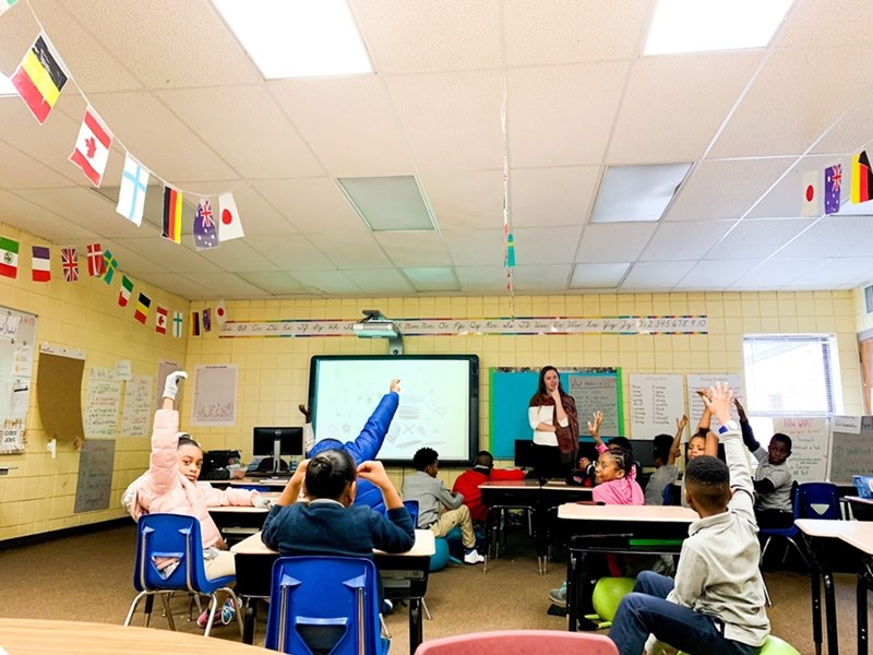 Delaney Wells, a Arkansas Teacher Corps Fellow, leads a discussion with her third-grade students at James Matthews Elementary in the Dollarway School District, which serves parts of Pine Bluff.