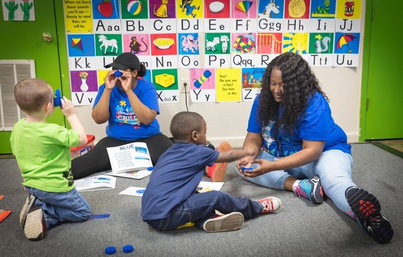 Behavior technicians in training work with children in the Arkansas Delta who have autism.