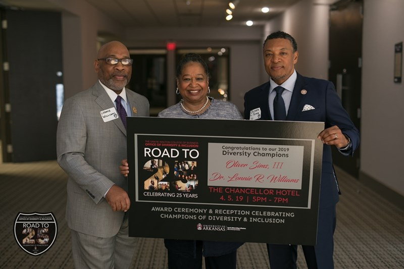 Barbara Lofton (center) presents Lonnie R. Williams, Ed.D., (left) and Oliver Sims III (right) with the Diversity Champions award on behalf of Walton College's Office of Diversity & Inclusion.