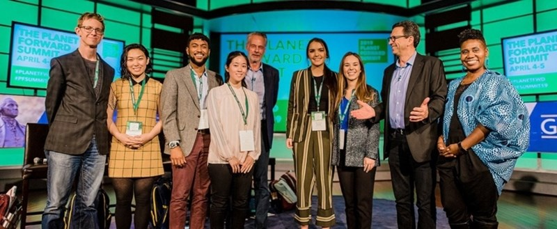 Haley Knighten (third from right) and Christina Trexler (center) celebrate with other Planet Forward award winners. Photo courtesy Planet Forward.