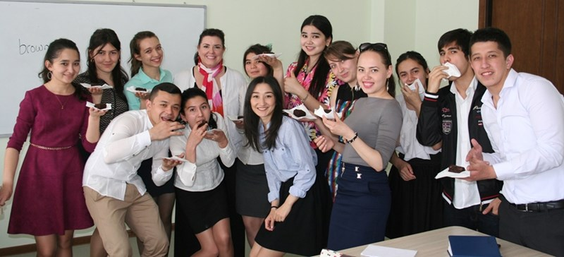 Christine Smart shares brownies with Uzbek students during her 2015-16 teaching fellowship.