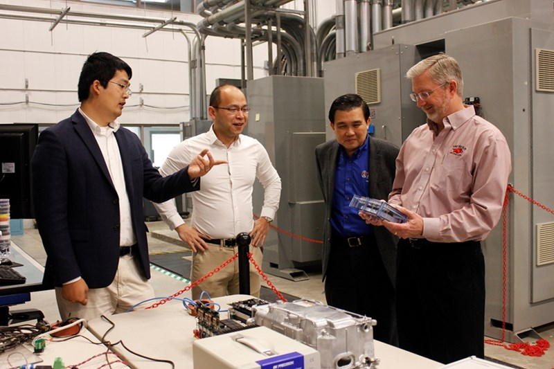 From left, NCREPT researchers Yue Zhao, Fang Luo, Simon Ang and Alan Mantooth inspect equipment inside the National Center for Reliable Electric Power Transmission. The researchers, along with Juan Balda (not pictured), are developing high power-density traction drives for hybrid and electric vehicles.