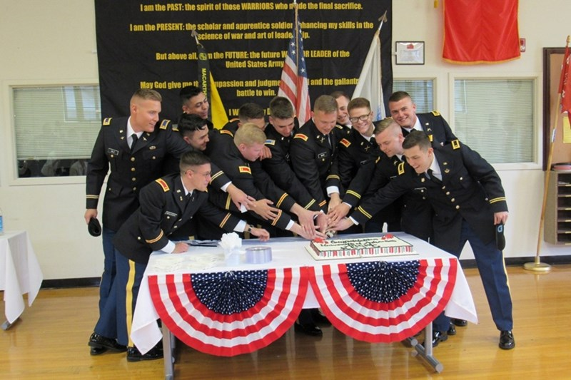 University of Arkansas Army ROTC's newest second lieutenants cut the cake with an Army saber at their reception last Friday.