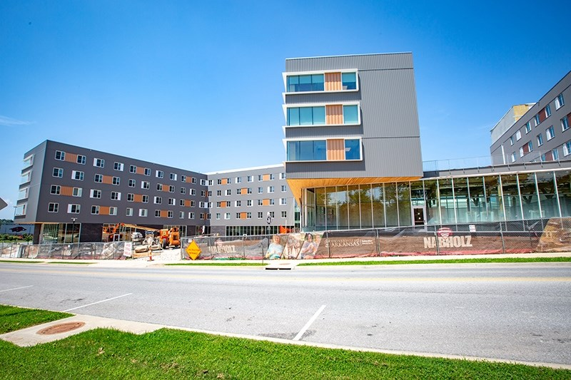 University of Arkansas researchers are collaborating to monitor the moisture content in the cross-laminated timber panels used to construct Adohi Hall, the new student residence hall on the Fayetteville campus.