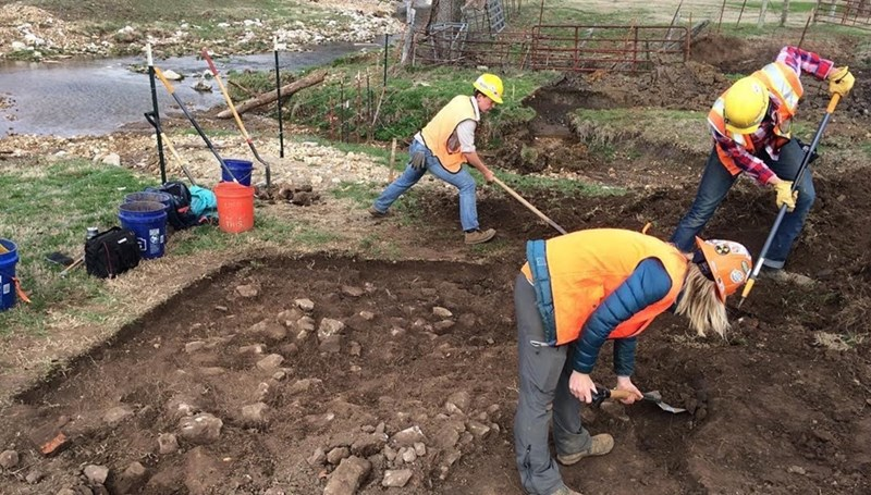 Archeological field technicians excavate during the final phase of the Rupple Road Street Extension project. In addition to material artifacts archeologists must be vigilant for potential human remains.