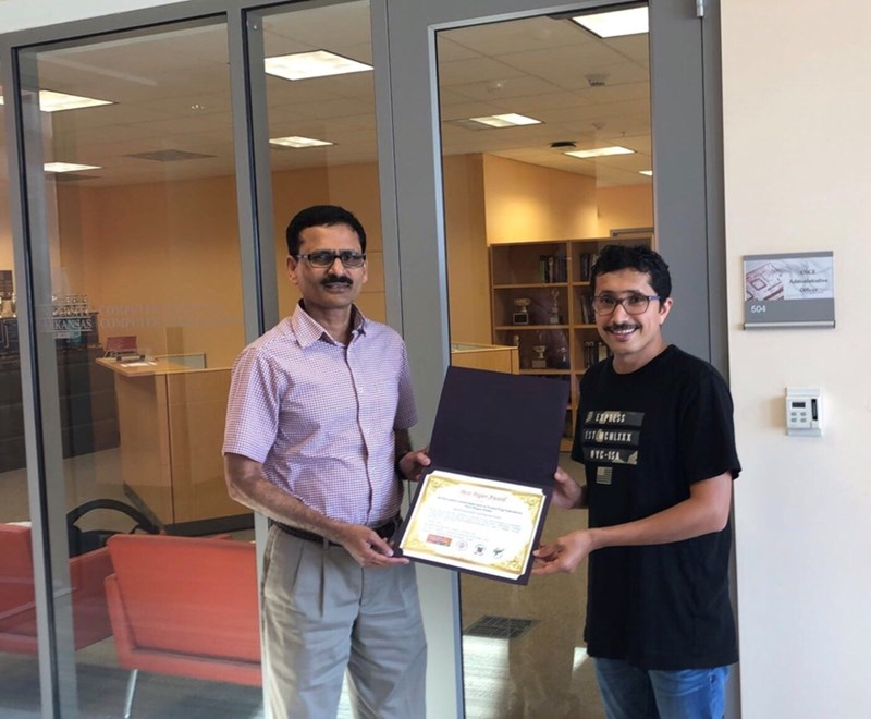 Brajendra Panda, professor of computer science and computer engineering, and doctoral student Mohammed Alshehri.