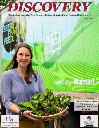 The Discovery 2019 cover features Bumpers College student Laura Wasson alongside the Seeds That Feed mobile food pantry that was the focus of her research on the effectiveness at increasing low-income residents' access to fresh produce through local mobile pantries. Wasson was the recipient of the 2019 Arkansas Outstanding Dietetics Student Award.