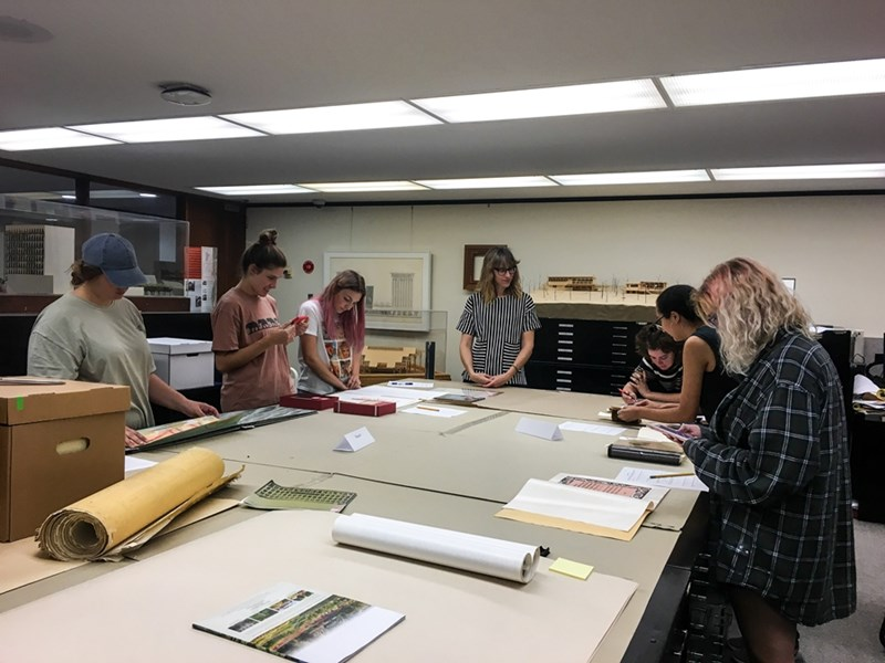 Intro to Printmaking students look at examples of printmaking techniques in Special Collections