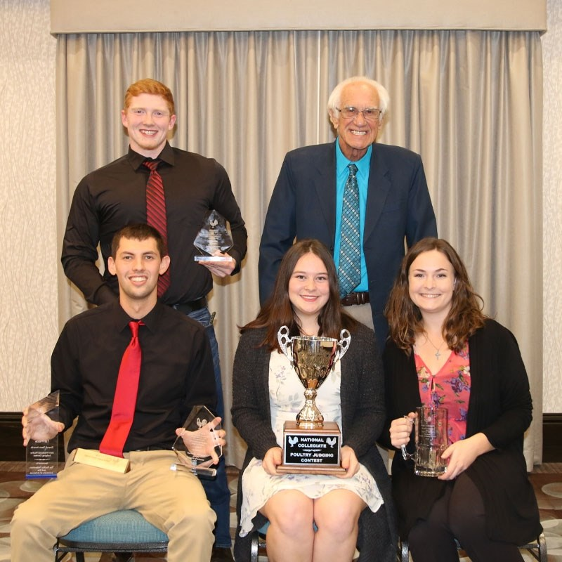 Members of the University of Arkansas National Poultry Judging Team are, sitting L to R: Brant Pritchett, Elsbeth Hamilton, Katie Bugenhagen; standing L to R: Jacob Russell and Dennis Mason, coach.