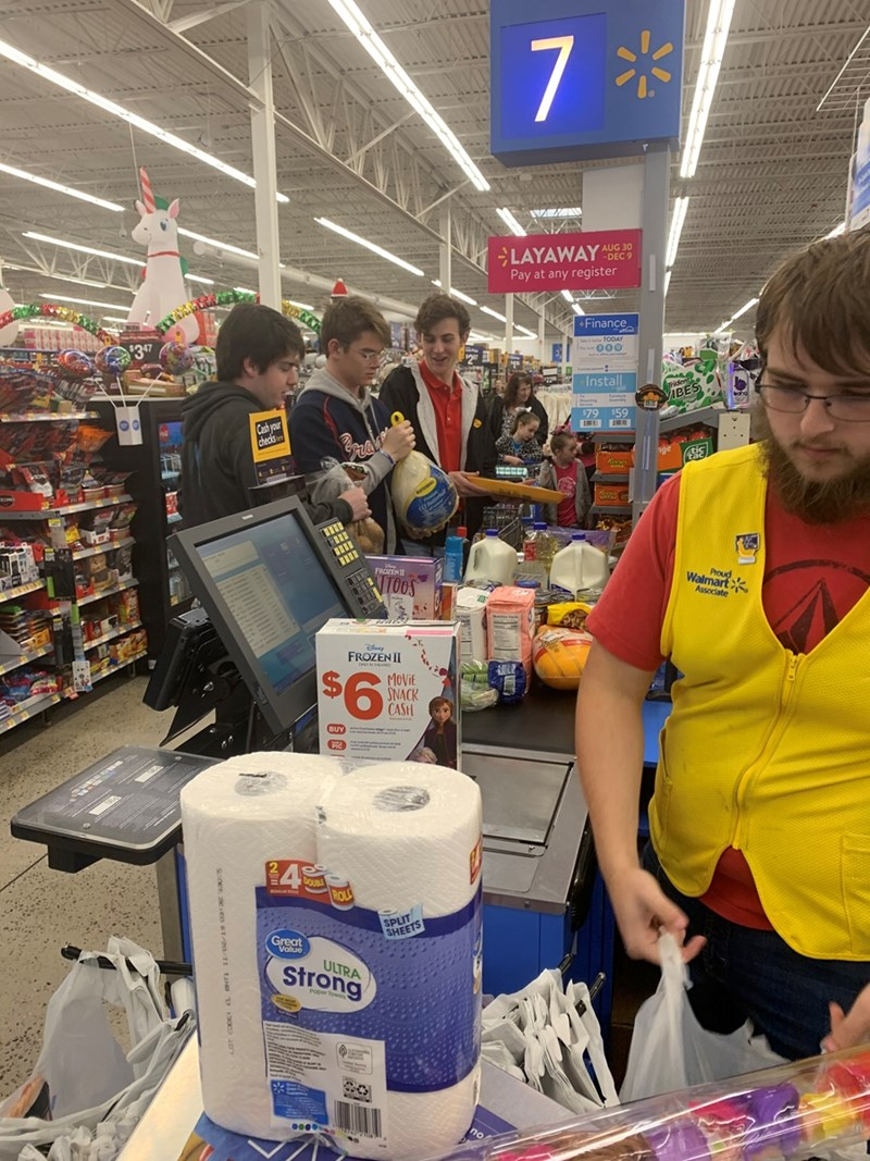 IFC fraternity leaders make purchases at the Wal-Mart SuperCenter on Martin Luther King Drive in an effort to help make this Thanksgiving special.