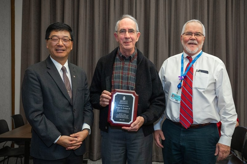 "From left, Dan Sui, vice chancellor for research and innovation; Roger Koeppe, Distinguished Professor of chemistry and biochemistry; and Robert ""Bobby"" McGehee, executive director of Arkansas Biosciences Institute and dean at UAMS Graduate School"