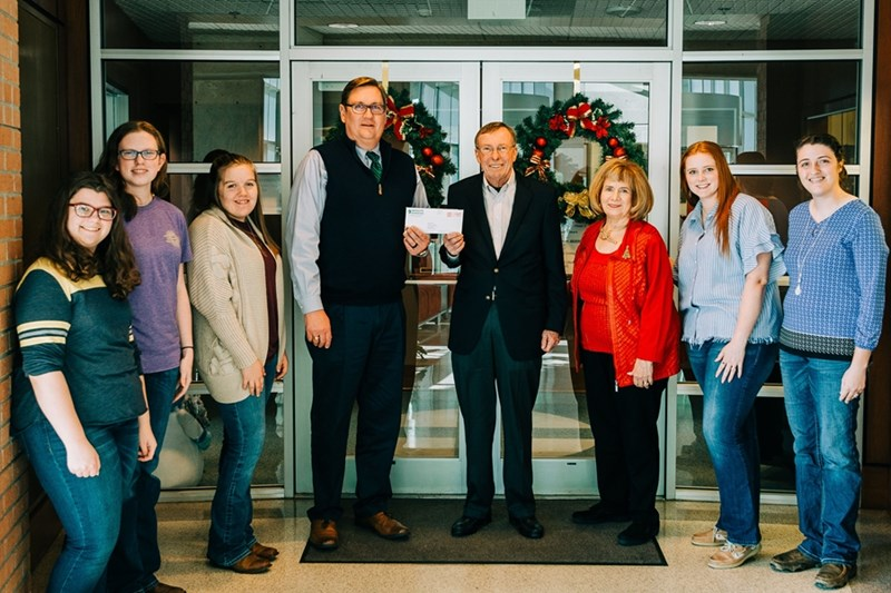 The USPoultry Foundation check is presented to the poultry science department. Pictured (L to R) are Katie Ann Sievert, Hannah Feuerborn and Renee Cude, poultry science students; Dr. David Caldwell, department head for the department of poultry science and director for the Center of Excellence for Poultry Science; Monty and Margo Henderson of the Monty and Margot Henderson Student Recruiting Fund; Payton McGinnis and Hannah Sherman, poultry science students.