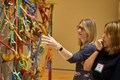 ARTeacher Fellows Tina South, left, and Penny Springmann examine a mixed-media installation in the galleries of Crystal Bridges Museum of American Art
