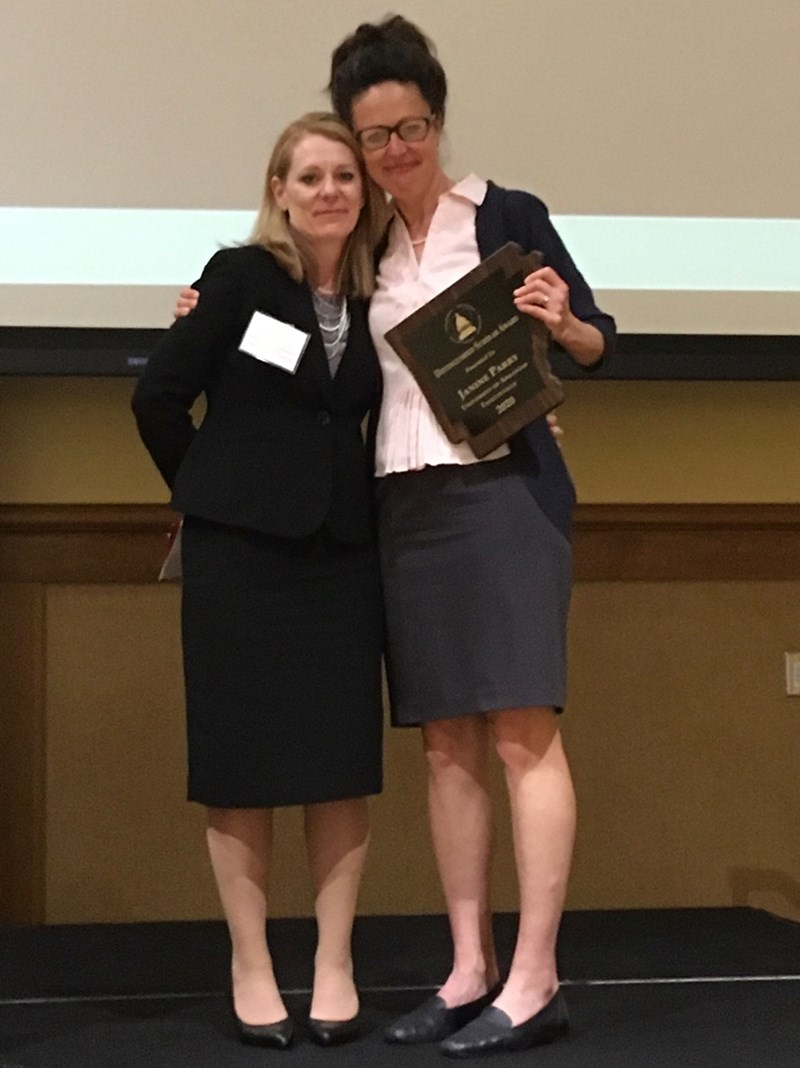 Karen Sebold awards the 2020 Arkansas Political Science Association's Distinguished Scholar to professor Janine Parry at the association's annual banquet.