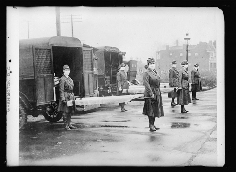 Members of the St. Louis Red Cross Motor Corps on duty during the 1918 flu pandemic.