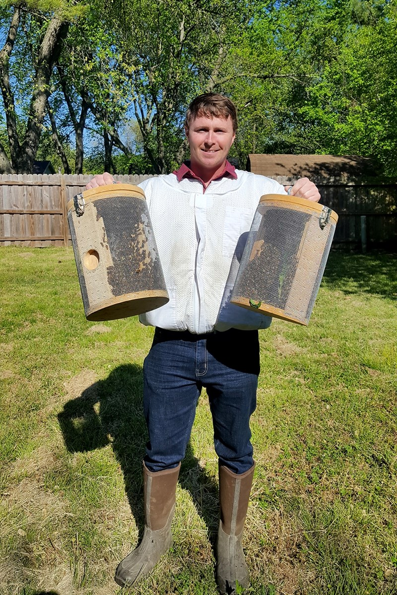 Caleb Hutcherson, an agricultural economics and agribusiness major in Bumpers College, is a registered beekeeper with a honeybee business. He relocates swarms from residential areas to help protect homeowners and pollinators.