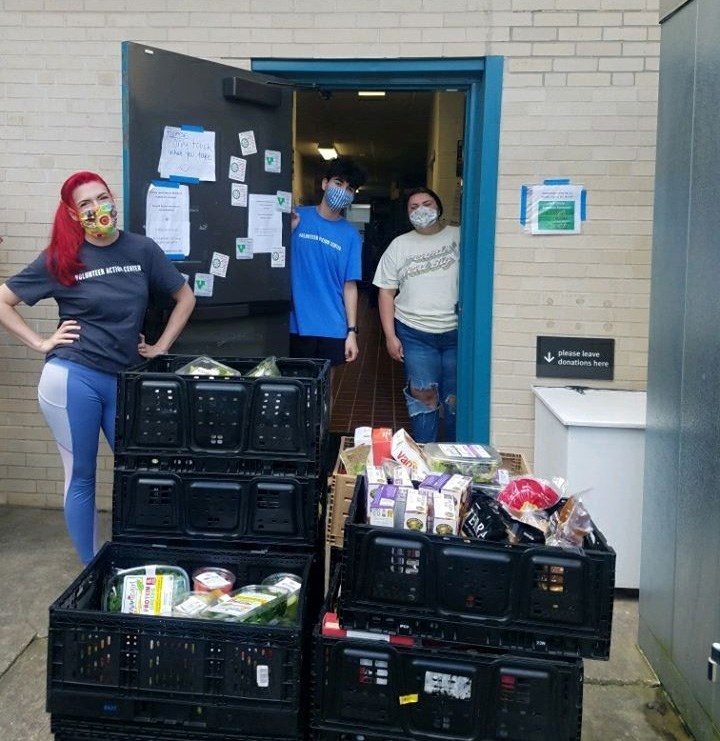Volunteers at the Jane B. Gearhart Full Circle Food Pantry load in a donation of food supplies.