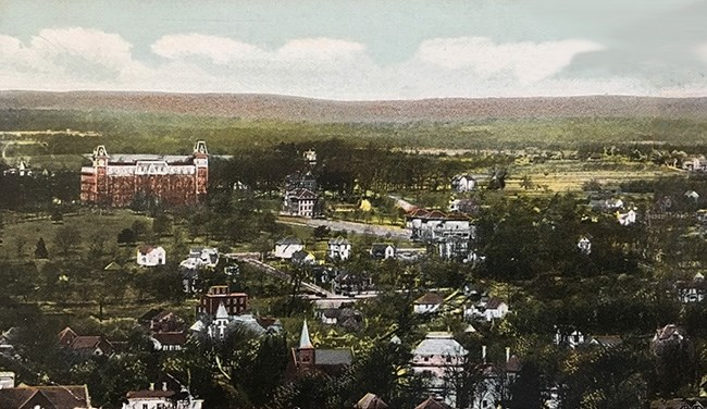 A post card from about 1910 shows Old Main towering above the countryside.