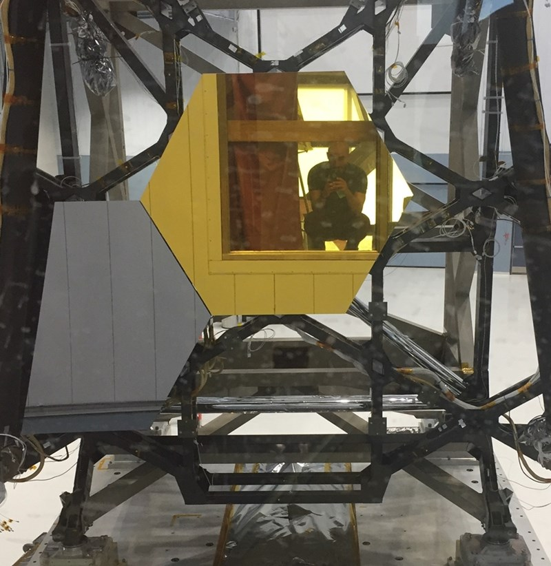 Part of the upcoming James Webb Space Telescope at Goddard Space Flight Center, now set to launch in 2021. Bonney is reflected in the mirror.