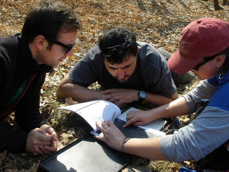 Prior to the COVID-19 pandemic, research team members Marius Robu, Alexandru Petculescu and Claire Terhune discuss where to look for fossils in the ?Oltet River Valley.