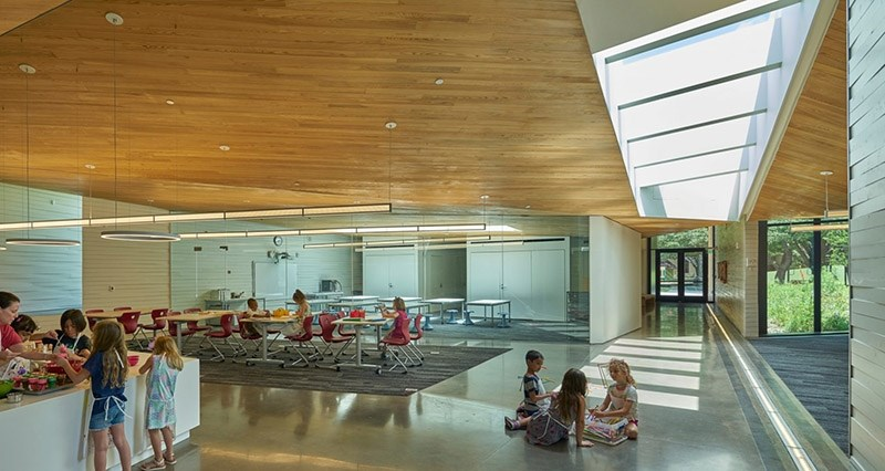 This view of the Lamplighter School Innovation Lab shows the teaching kitchen looking toward a maker space and robotics lab.
