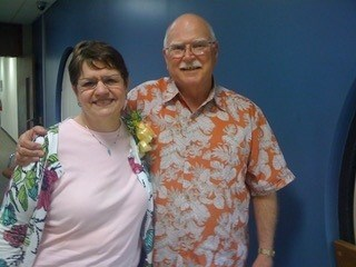 Susan Mayes and Charles Riggs at his retirement party in 2011.