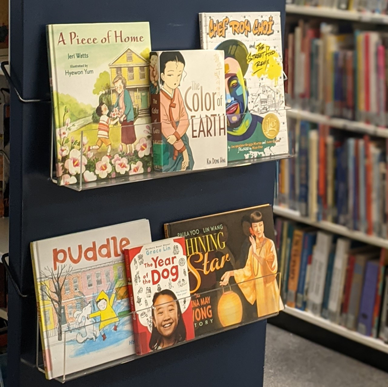 A display of books for Asian American and Pacific Islander Heritage Month in the Children's Literature Collection, located on the lobby level of Mullins Library.