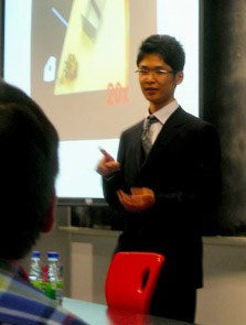 Honors engineering/psychology student Akihiro Eguchi presents research on a housecleaning robot prototype at a conference in Montreal, Canada.