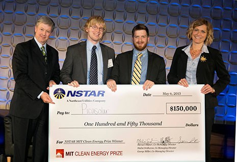 Craig Hallstrom (far left), president of NSTAR Electric, congratulates team mentor Douglas Hutchings (left to right); Seth Shumate, Picasolar; and Trish Flanagan, Picasolar. Photo courtesy Michael Fein.